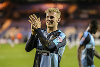Jason McCarthy of Wycombe Wanderers applauds the travelling fans after the Sky Bet League 2 match between Luton Town and Wycombe Wanderers at Kenilworth Road, Luton, England on 26 December 2015. Photo by David Horn.