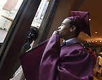 Oscar DeJesus, blows a kiss to family and friends looking in from outside the theater, prior to the Windsor High School graduation ceremony, Tuesday, June 14, 2016, at the Bushnell Theater in Hartford. (Jim Michaud / Journal Inquirer)