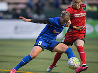 Seattle, WA - Saturday, May 14, 2016: Seattle Reign FC forward Merritt Mathias (9) battle for the ball with Portland Thorns FC midfielder Meleana Shim (6) during the second half The Portland Thorns FC and the Seattle Reign FC played to a 1-1 tie during a regular season National Women's Soccer League (NWSL) match at Memorial Stadium.