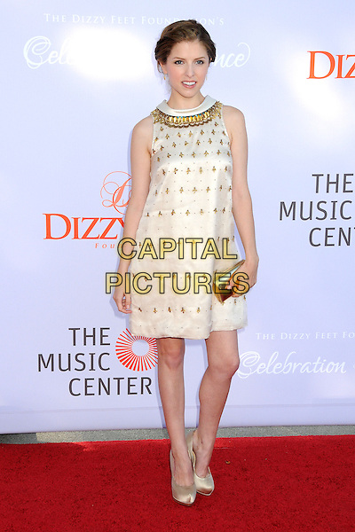 Anna Kendrick<br /> 3rd Annual Dizzy Feet &quot;Celebration of Dance&quot; Gala held at the Dorothy Chandler Pavilion,  Los Angeles, California, USA, 27th July 2013.<br /> full length dress smiling gold white cream embellished sleeveless clutch bag satin silk shoes <br /> CAP/ADM/BP<br /> &copy;Byron Purvis/AdMedia/Capital Pictures