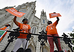 Jacqueline Patrick (left) and Tiffani Anderson hold up signs outside St. Alphonsus Liguori Catholic Church before the Wear Orange Day March against gun violence started from there on Saturday June 2, 2018. The marchers proceeded north on North Grand Boulevard to the Herbert Hoover Boys & Girls Club where a rally and resource fair were held. June is National Gun Violence Awareness Month.<br /> Photo by Tim Vizer
