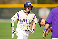 Cody Jones (12) of the Western Carolina Catamounts rounds third base after hitting a solo home run in the top of the 9th inning against the Davidson Wildcats at Wilson Field on March 10, 2013 in Davidson, North Carolina.  The Catamounts defeated the Wildcats 5-2.  (Brian Westerholt/Four Seam Images)