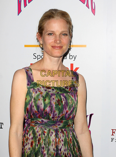 "BRIDGET FONDA.Film Independent Screening Of ""Taking Woodstock"" held At The Arclight Theatre, Hollywood, California, USA..August 4th, 2009.half length dress green purple pattern .CAP/ADM/KB.©Kevan Brooks/AdMedia/Capital Pictures."