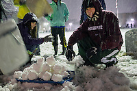 Campus Snow Day - students with snowballs<br />