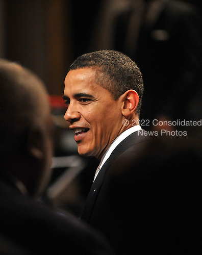 """Washington, D.C. - February 25, 2009 -- United States President Barack Obama greets guests as he and first lady Michelle Obama host """"Stevie Wonder In Performance at the White House: The Library of Congress Gershwin Prize"""" to showcase an evening of celebration at the White House in honor of musician Stevie Wonder's receipt of the Library of Congress Gershwin Prize for Popular Song in the East Room of the White House in Washington, D.C. on Wednesday, February 25, 2009..Credit: Ron Sachs / Pool via CNP"""