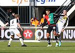 Nederland, Nijmegen, 2 december 2012.Eredivisie .Seizoen 2012-2013.N.E.C.-NAC Breda.Victor Palsson (2e van rechts.) van N.E.C. en Tim Gilissen (l.) van NAC Breda strijden om de bal. Nemanja Gudelj (r.) van NAC Breda is inmiddels gepasseerd.
