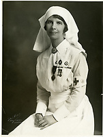 Formal portrait of Madeleine Frances Jaffray in nurses' uniform. circa 1919<br /> <br /> <br />  Madeleine Jaffray volunteered with the French Flag Nursing Corps, Red Cross in 1915 and served in French field hospitals during the World War I. In 1917, she was wounded while stationed at Adinkerke, Belgium during German bombardment, resulting in the amputation of her leg. In recognition of her service, she became the first Canadian woman to be awarded the French Croix de Guerre. From the Madeleine Morrison fonds, PR1986.0054/4.