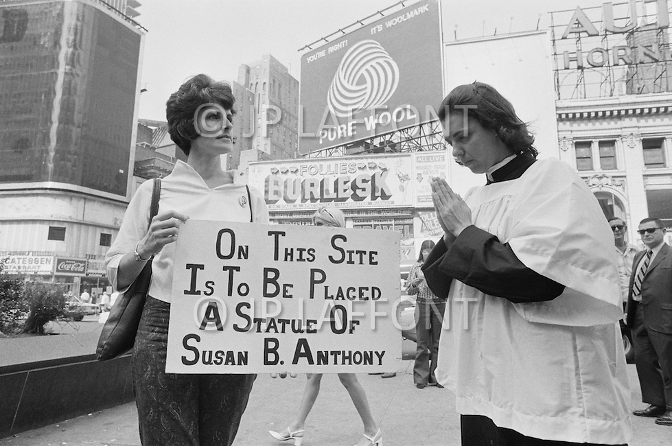 26 Aug 1970, Manhattan, New York City, New York State, USA --- A demonstrator holds a sign in Times Square as the location for a statue of feminist and civil rights leader Susan B. Anthony on August 26, 1970. The day marked the 50th anniversary of the passing of the Nineteenth Amendment which granted American women full suffrage. --- Image by © JP Laffont/Sygma/CORBIS