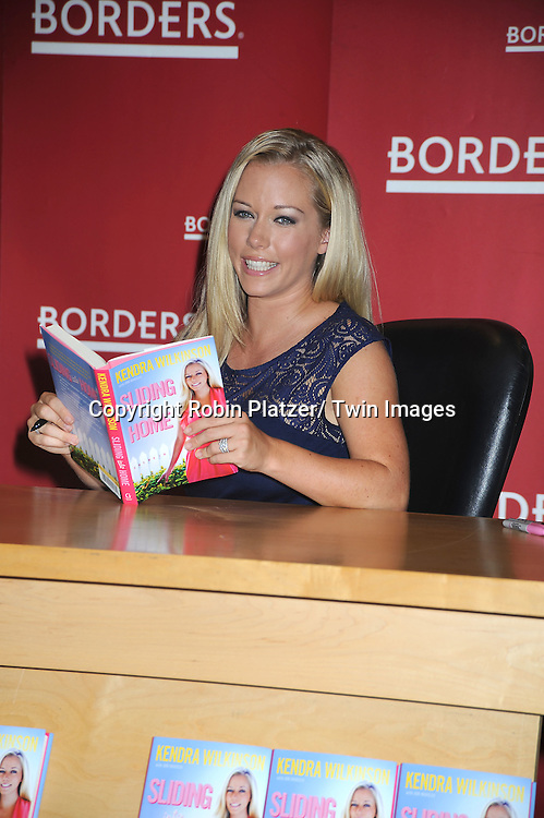 "Kendra Wilkinson posing at her book signing for ""Sliding into Home"" on July 6, 2010 at Border's at Columbus Circle in New York City."