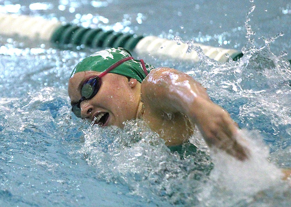 Denton, TX - FEBRUARY 1: Lainey Parham competes in the 400 yard freestyle relay  with the team placing eighth against the Texas A&M Aggies at the Pohl Recreation Center on February 1, 2013 in Denton, Texas. (Photo by Rick Yeatts)