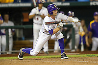 LSU Tiger outfielder Raph Rhymes (4) squares to bunt in the ninth inning of Game 4 of the 2013 Men's College World Series against the UCLA Bruins on June 16, 2013 at TD Ameritrade Park in Omaha, Nebraska. UCLA defeated LSU 2-1. (Andrew Woolley/Four Seam Images)