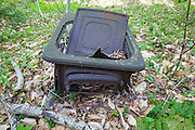 An old Hearth & Home stove along Meadow Brook in Franconia, New Hampshire USA. The removal of historical artifacts from federal lands without a permit is a violation of federal law.
