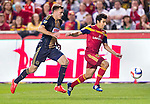 Real Salt Lake defender Tony Beltran (2) keeps the ball away from Philadelphia Union forward Andrew Wenger (11) in the first half Saturday, March 14, 2015, during the Major League Soccer game at Rio Tiinto Stadium in Sandy, Utah. (© 2015 Douglas C. Pizac)