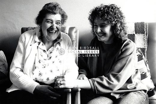 Carer and elderly woman in residential home for the elderly, Nottingham UK 1991