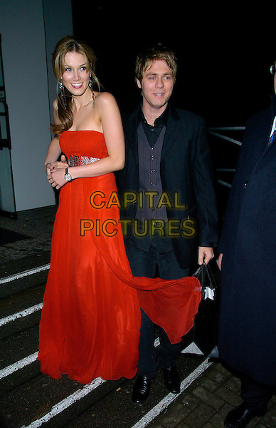 DELTA GOODREM &amp; Brian McFADDEN<br /> TAG Heuer Strength &amp; Beauty Exhibition - opening night party, Royal College Of Art (RCA), London, UK.<br /> February 8th, 2007<br /> full length black jacket waistcoat red sheer strapless dress couple Brian<br /> CAP/CAN<br /> &copy;Can Nguyen/Capital Pictures