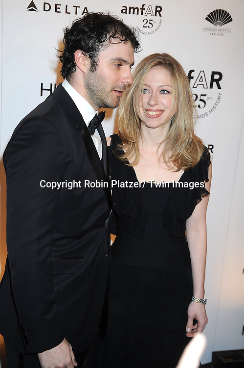 Chelsea Clinton and husband Mark Mezvinsky attending the amfAR New York Gala on February 9, 2011 at Cipriani Wall Street in New York City. Dame Elizabeth Taylor, President Bill Clinton and Diane von Furstenberg were honored.