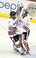 Nebraska-Omaha goalie Dayn Belfour and Matt Smith celebrate a win. Nebraska-Omaha defeated Colorado College 7-5 Friday night at CenturyLink Center in Omaha. (Photo by Michelle Bishop) .
