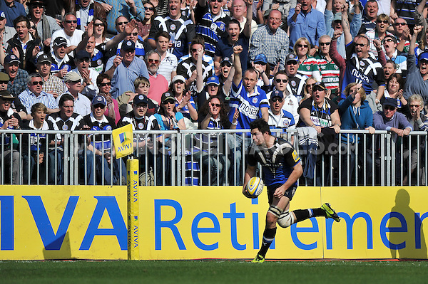 Bath supporters in the crowd celebrate as Francois Louw has a clear run to the try-line. Aviva Premiership match, between Bath Rugby and Leicester Tigers on April 20, 2013 at the Recreation Ground in Bath, England. Photo by: Patrick Khachfe / Onside Images