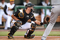 Jacksonville Suns catcher J.T. Realmuto (11) during game three of the Southern League Championship Series against the Chattanooga Lookouts on September 12, 2014 at Bragan Field in Jacksonville, Florida.  Jacksonville defeated Chattanooga 6-1 to sweep three games to none.  (Mike Janes/Four Seam Images)