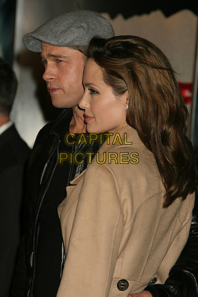 "BRAD PITT & ANGELINA JOLIE.""Beowulf"" Los Angeles Premiere held at Mann's Village Theatre, Westwood, California, USA..November 5th, 2007.half length black leather jacket beige tan coat gray gray hat cap flat profile couple .CAP/ADM/RE.©Russ Elliot/AdMedia/Capital Pictures."