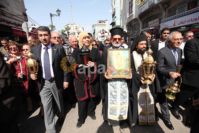 """Palestinian Prime Minister Salam Fayyad joins Christian Orthodox annual celebrations of the """"Holy Fire"""" in the West Bank city of Ramallah May 4, 2013. Photo by Issam Rimawi"""