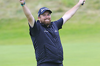 Shane Lowry (IRL) sinks his par putt on the 18th green to win the Championship by 6 shots at the end of Sunday's Final Round of the 148th Open Championship, Royal Portrush Golf Club, Portrush, County Antrim, Northern Ireland. 21/07/2019.<br /> Picture Eoin Clarke / Golffile.ie<br /> <br /> All photo usage must carry mandatory copyright credit (© Golffile | Eoin Clarke)