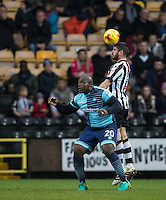 Richard Duffy of Notts Co beats Adebayo Akinfenwa of Wycombe Wanderers in the air during the Sky Bet League 2 match between Notts County and Wycombe Wanderers at Meadow Lane, Nottingham, England on 10 December 2016. Photo by Andy Rowland.