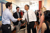 President Barack Obama greets campaign staffers during a surprise stop to his campaign headquarters on the Downtown Mall in Charlottesville, VA.