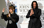 """Actor Keanu Reeves (R) and singer Kyary Pamyu Pamyu pose of the ninja during a stage greeting for the movie """"John Wick: Chapter 3 - Parabellum"""" in Tokyo, Japan, September 10, 2019. The movie will be released in Japan on October 4. JIJI PRESS PHOTO / MORIO TAGA"""