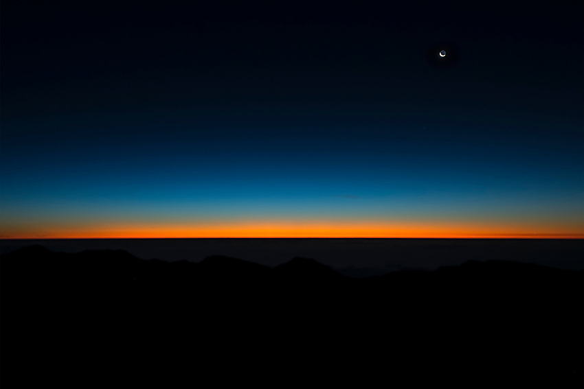 View from the rim of the crater of Mt. Haleakala (elev. 10,000 ft) 40 minutes before sunrise. Mt. Haleakala is a dormant volcano that forms the majority of the land area of Maui.