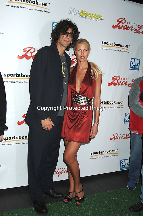 "Howard Stern and Beth Ostrosky..arriving at The New York Premiere of ""Artie Lange's ..Beer League on September 13, 2006 at The Ziegfeld Theatre. ..Robin Platzer, Twin Images"