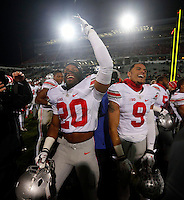 Ohio State Buckeyes defensive back Ron Tanner (20) and Ohio State Buckeyes wide receiver Devin Smith (9) against Michigan State Spartans at Spartan Stadium in East Lansing, Michigan on November 8, 2014.  (Dispatch photo by Kyle Robertson)
