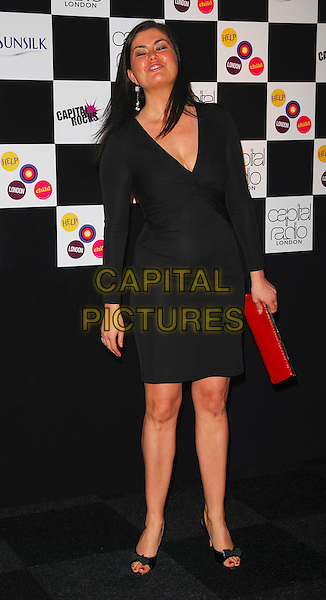 AMANDA LAMB.At the Capital Rocks! Party, .Battersea Park Events Arena, London, .England, December 12th 2006..full length black dress funny.CAP/CAN.©Can Nguyen/Capital Pictures