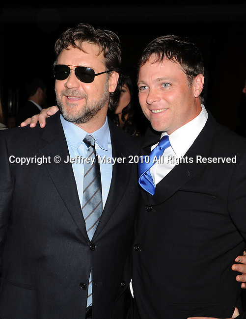 "WEST HOLLYWOOD, CA. - November 16: Russell Crowe and Michael Buie arrive at the special screening of ""The Next Three Days""  at the Director's Guild of America on November 16, 2010 in West Hollywood, California."