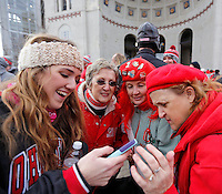 (From left) Jacqueline Barsamian, Elaine Klopfenstein, Lynne Klopfenstein and Andrea Borders look over a video they took of the coaches and players entering the stadium before the NCAA football game against Michigan at Ohio Stadium on Saturday, November 29, 2014. (Columbus Dispatch photo by Jonathan Quilter)