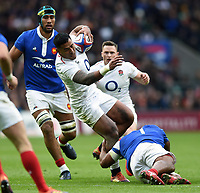 Manu Tuilagi of England is tackled. Guinness Six Nations match between England and France on February 10, 2019 at Twickenham Stadium in London, England. Photo by: Patrick Khachfe / Onside Images