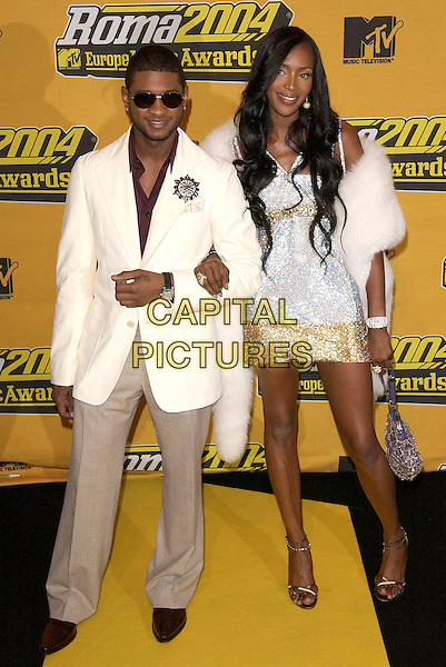 USHER & NAOMI CAMPBELL.MTV Europe Music Awards,.Tor Di Valle, Rome, Italy, November 18th 2004..full length silver gold dress white fur cape shawl wrap sunglasses.Ref: DH.www.capitalpictures.com.sales@capitalpictures.com.©David Hitchens/Capital Pictures .