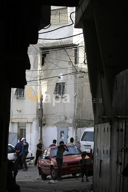 A Palestinian refugees walk through the narrow streets of the Shuafat refugee camp in Jerusalem on May 11, 2010. Palestinians are marking May 15, as Nakba Day or Catastrophe Day, as the 62nd anniversary of the al-Nakba, the day the Israeli state was created in 1948 Photo by Issam Rimawi..