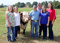 NWA Democrat-Gazette/DAVID GOTTSCHALK Cheyenne Moyer (from left) stands with her mother Dyanna, Paul Cole, father Jerry Moyer, Dixie Miller and sister Caleigh Moyer Monday, June 11, 2018, in the pasture on their Washington County Farm. The Moyer family was chosen as Washington County's Farm Family of the Year. The family raises broilers and Hereford cattle.
