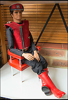 BNPS.co.uk (01202 558833)<br /> Pic: TomWren/BNPS<br /> <br /> Captain Scarlett with his cloudbase seat.<br /> <br /> A Thunderbirds fanatic who always dreamt of owning an original Parker puppet now earns a living making them for fellow fans.<br /> <br /> Duncan Willis, 59, made his first puppet 15 years ago and his hobby has grown into a business where he creates puppets of the show's best-loved characters including Parker, Lady Penelope and Jeff Tracy. <br /> <br /> Mr Willis makes and sells about 20 Thunderbirds puppets a year at his home in Whiteley, Hampshire, together with elaborate props for them because he doesn't want them to be stood 'with a rod up their backside'. <br /> <br /> The puppets, which measure between 19 and 23in, take him four to six weeks to craft and cost in the region of &pound;900.