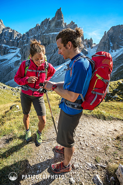 Couple using an iPhone as a GPS while hiking the Dolomites Alta Via 2