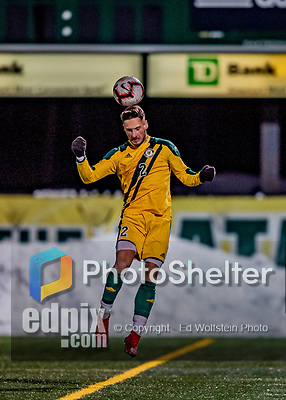 13 November 2019: University of Vermont Catamount Defender Adrian Gahabka, a Senior from Passau, Germany, heads the ball forward during game action against the University of Hartford Hawks at Virtue Field in Burlington, Vermont. The Catamounts fell to the visiting Hawks 3-2 in sudden death overtime of the Division 1 Men's Soccer America East matchup. Mandatory Credit: Ed Wolfstein Photo *** RAW (NEF) Image File Available ***
