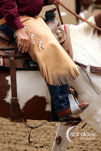 A cowboy working the Greeley Stampede Rodeo sports a short pair of chaps called chinks. Chinks enable a cowboy to maneuver more freely when working, and not dragging the ground.