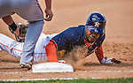 12 March 2014: Houston Astros outfielder L.J. Hoes dives safely back to first during a Spring Training game against the Washington Nationals at Osceola County Stadium in Kissimmee, Florida. The Astros rallied in the bottom of the 9th to edge out the Nationals 10-9 in Grapefruit League play. Mandatory Credit: Ed Wolfstein Photo *** RAW (NEF) Image File Available ***