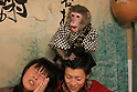 "October 22, 2016, Utsunomiya, Japan - A Japanese macaque Fuku (meaning happiness) plays with guests at an izakaya, Japanese pub ""Kayabuki"" in Utsunomiya, 100km north of Tokyo on Saturday, October 22, 2016. The pub master Kaoru Otsuka trains Japanese macaques to help him and show their entertainment skills to attract customers including lots of foreign tourists.   (Photo by Yoshio Tsunoda/AFLO) LWX -ytd-"