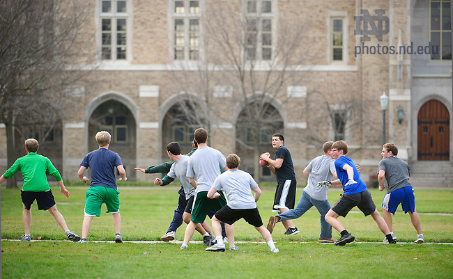 Dec. 3, 2012; Students enjoy an unseasonably warm afternoon while playing a game of touch football on South Quad. Photo by Barbara Johnston/University of Notre Dame