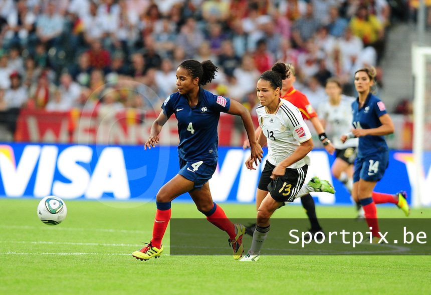 Fifa Women's World Cup Germany 2011 : France - Germany ( Frankrijk - Duitsland ) at Munchengladbach World Cup stadium : Laura GEORGES aan de bal voor Celia OKOYINO DA MBABI.foto DAVID CATRY / Vrouwenteam.be