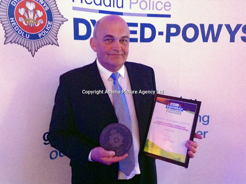 Pictured: PC Meirion Jenkins, who won an award for his work in investigating this case<br /> Re: Dyfed-Powys Police has used DNA evidence to secure a conviction against a man for handling stolen sheep – the first time evidence of its kind has been used in a conviction in Wales.<br /> Andrew Paul Thomas, aged 39, of Bryncethin Road, in Garnant, admitted the charge of handling stolen property, having previously pleaded not guilty on the first day of a trial at Swansea Crown Court. He is due to be sentenced on April 11.<br /> Forensic techniques usually reserved for humans were used to gather DNA from the sheep by the Animal Plant Health Agency, which formed crucial evidence to the prosecution case.<br /> The theft of 50 sheep from the Derwydd area of Ammanford was reported in January 2015, and the victim started his own enquiries to trace them in the farming community. He discovered 21 sheep suspected of being his, which had been sold at Llanybydder Livestock Market less than two weeks after being reported stolen. <br /> Ammanford officer PC Meirion Jenkins wanted to prove beyond reasonable doubt that the animals belonged to the victim. He sought advice from the force's rural crime specialist Acting Inspector Matthew Howells, who assisted with the coordination of the use of DNA evidence by the Animal and Plant Health Agency (APHA).