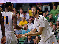 Cole Dickerson of USF celebrates with De'End Parker of USF during the game against St. John's at War Memorial Gym in San Francisco, California on December 4th, 2012.   USF Dons defeated St. John's, 81-65.