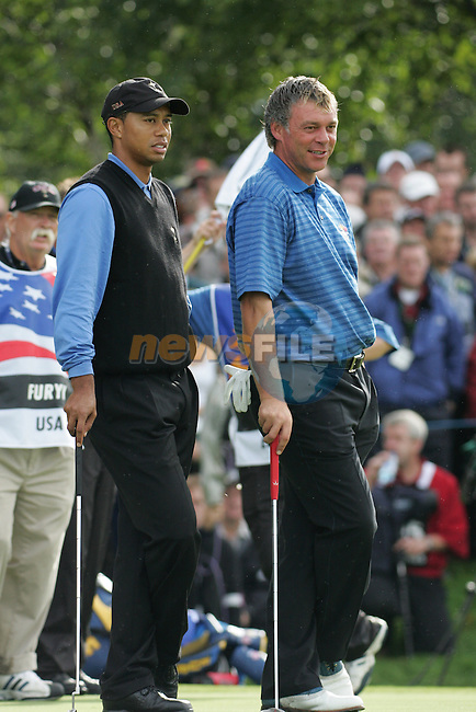 Ryder Cup 206 K Club, Straffin, Ireland...American Tiger Woods laughs with European Darren Clarke on the 9th green during  the morning fourballs session of the second day of the 2006 Ryder Cup at the K Club in Straffan, Co Kildare, in the Republic of Ireland, 23 September 2006...Photo: Eoin Clarke/ Newsfile.